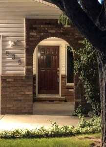 535 Oriole vine covered brick archway entry