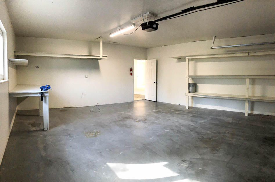 2-car garage at 535 Oriole has shelving & a workbench