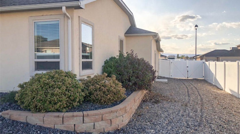 The graveled RV parking area is accessible from the garage, and tucked behind a 10-foot access gate.