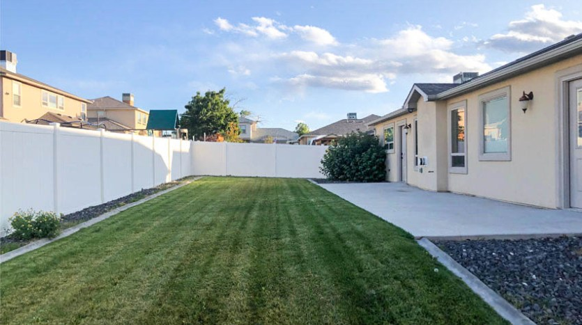 164 Winter Hawk Drive has a large, grassed back yard with a concrete patio, garden area, and times & pressurized irrigation.