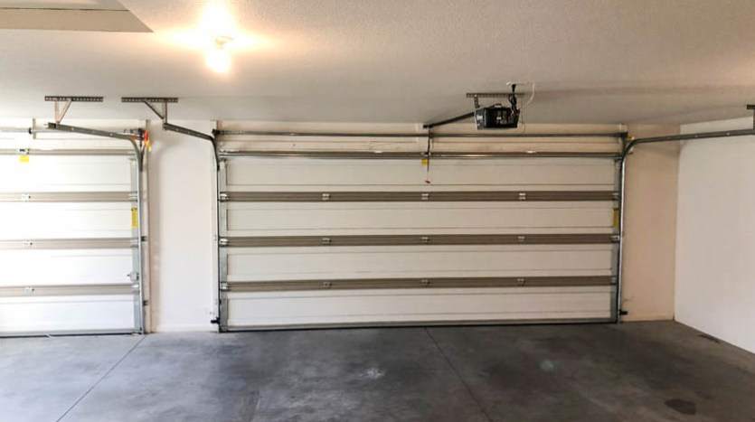 The large 3-car garage of 164 Winter Hawk Drive.
