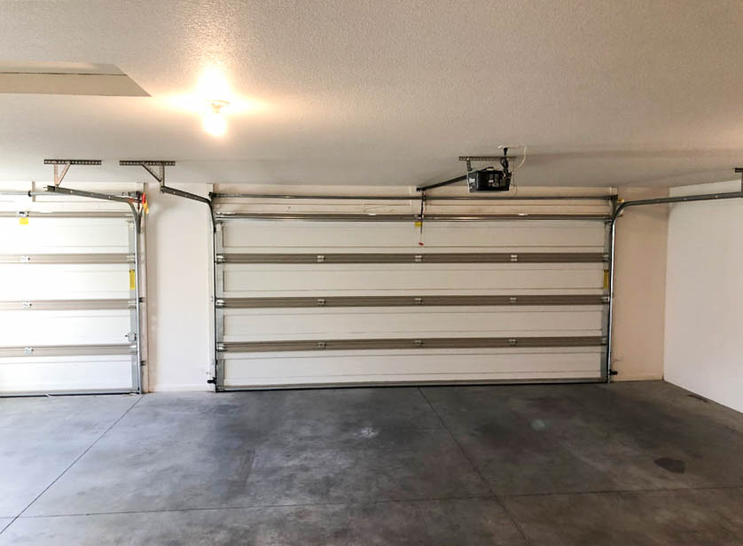 The large 3-car garage of 164 Winter Hawk Drive.