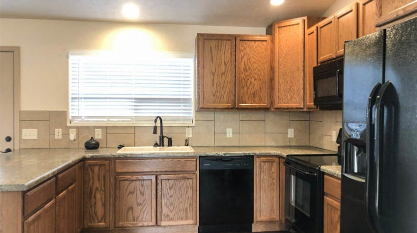 The kitchen of 164 Winter Hawk includes all appliances - with a brand new microwave! - and a breakfast bar