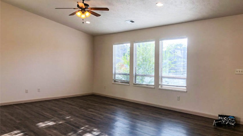 The living room of 164 Winter Hawk has 3 large, west-facing windows to let in natural light.