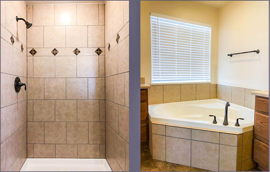 The master bath of 164 Winter Hawk has a corner soaking tub and a step-in shower.
