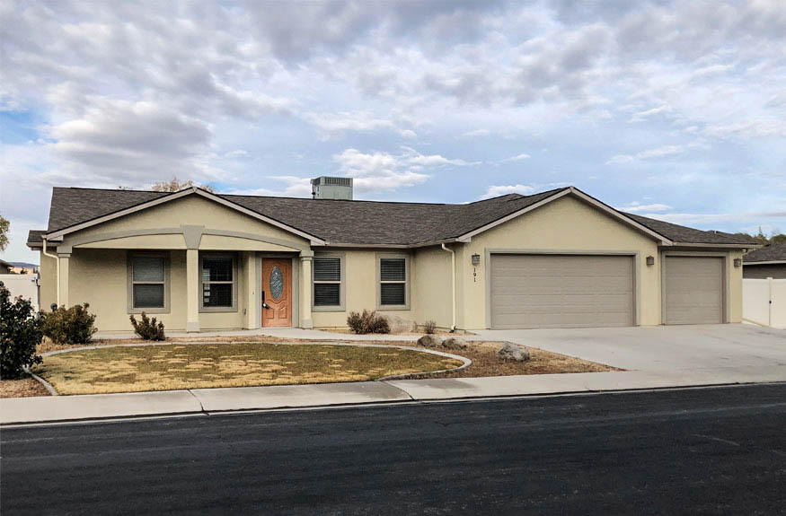 191 Winter Hawk Dr. is a 3 bedroom 2 bath home in Grand Junction. The open concept living area opens to a partially covered back patio and large back yard through double glass doors. The Patio wraps around to the Master Suite, which includes a 5-piece ensuite with a soaking tub, step-in shower, large storage vanity with double sinks and a toilet. The bedrooms are all private from one another. 3 car garage + RV parking behind a 10-foot access gate.