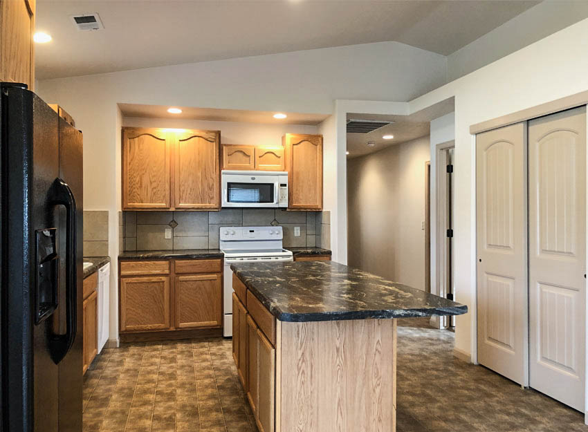 The kitchen of 191 Winter Hawk includes all appliances, a storage island with breakfast bar, and a small pantry.