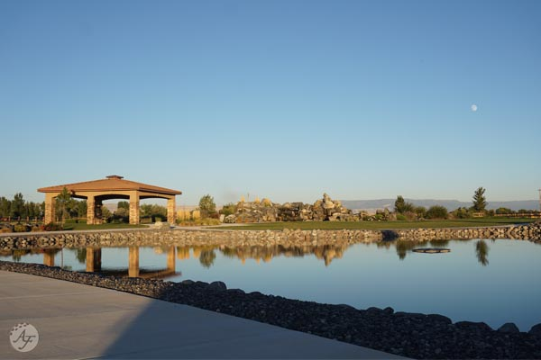 Looking east across the Adobe Falls Park pond & gazebo towards the Grand Mesa