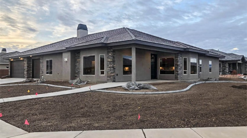 1329 Niblick Way, Fruita, CO a 4 bedroom, 3 bath home with a 3+ car garage and RV parking.