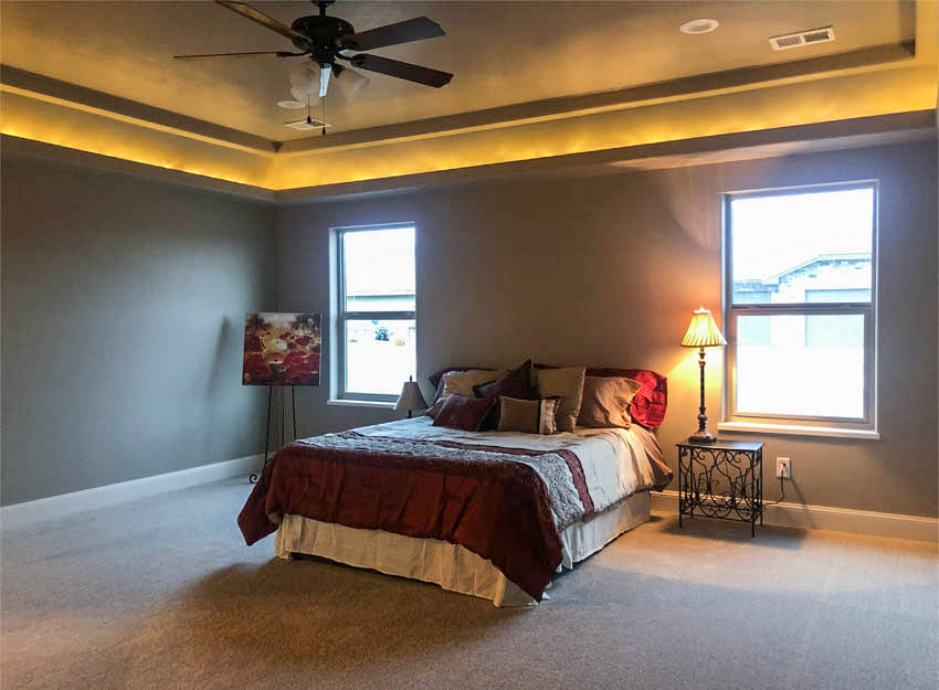 The master bedroom of 1329 Niblick Way has hidden LED lighting near the ceiling providing an ambient glow.