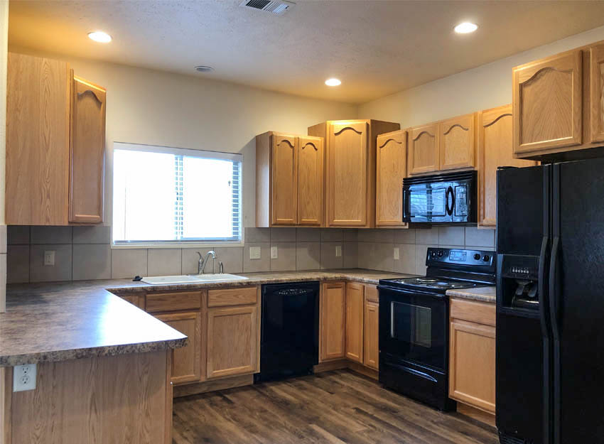 The kitchen includes the appliances, a breakfast bar, and has two pantries!
