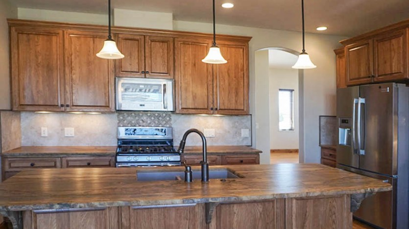 The island in the center of the kitchen offers seating and prep space galore!