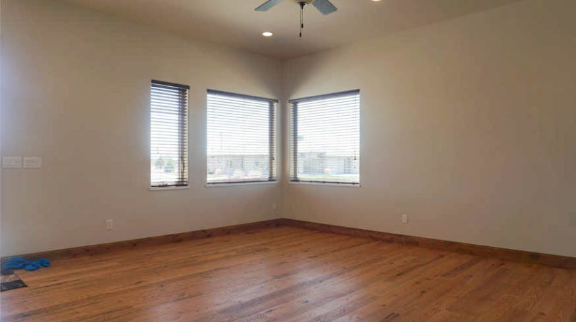 Large windows look out at the views of the Grand Mesa and Colorado National Monument from the living room of 1485 Adobe Falls Way.