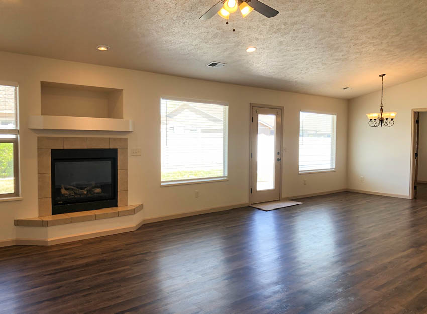 The living and dining areas of 183 Winter Hawk are laid out in a great room style with a gas fireplace and access to the back patio.