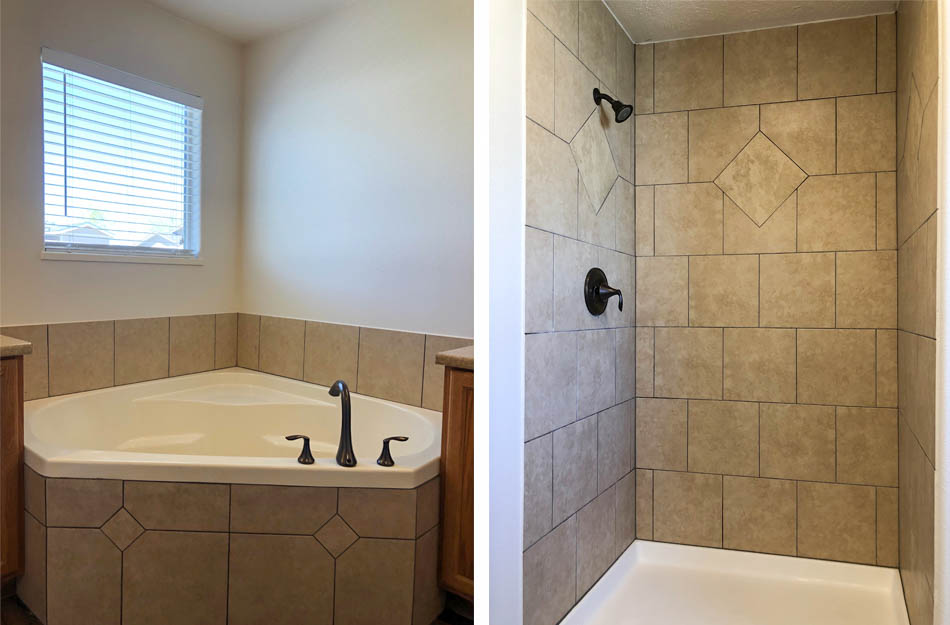 The corner soaking tub and step-in shower in the master bathroom of 183 Winter Hawk Dr.