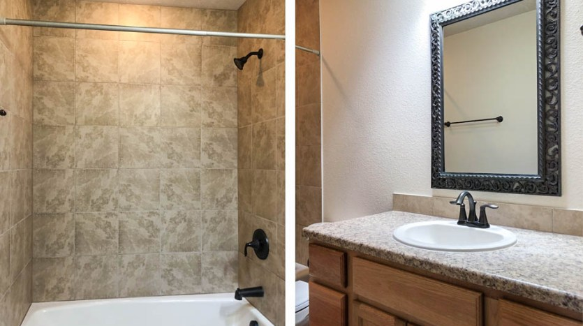The hall bath is a full bath with an in-tub shower, toilet, and storage vanity with a sink.