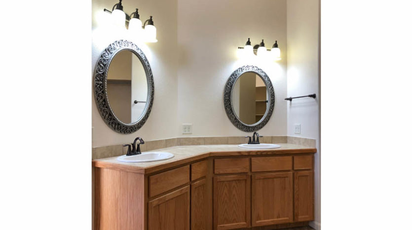 The vanity in the master bath has double sinks and lots of storage space.