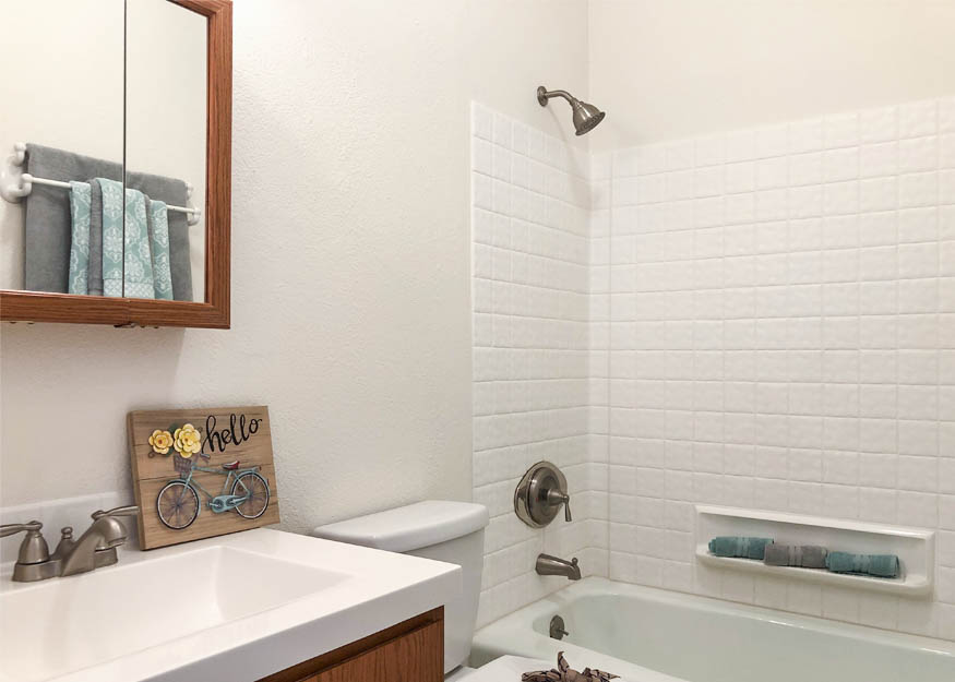 The hall bath of 103 Bacon Ct #3 has been remodeled with new flooring, and newer sink & toilet.