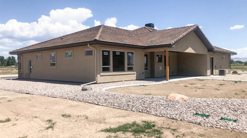 1484 Shoreline Drive has a west facing covered back patio overlooking the back yard. The irrigation and decorative rock for landscaping has been installed.