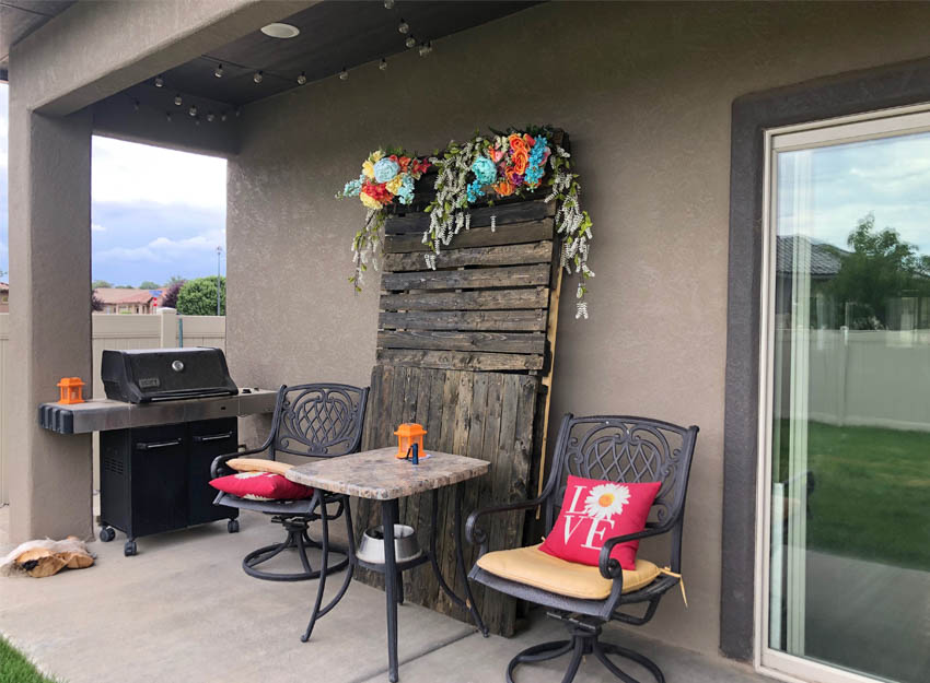The covered back patio of 2840 Kelso Mesa Drive has space for a small table & chairs overlooking the back yard.
