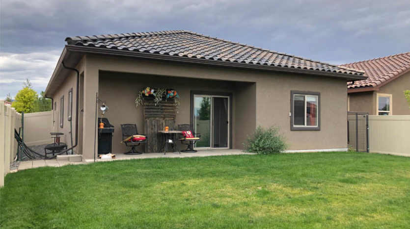 The back patio of 2840 Kelso Mesa Drive is covered, and has space for a table and chairs.