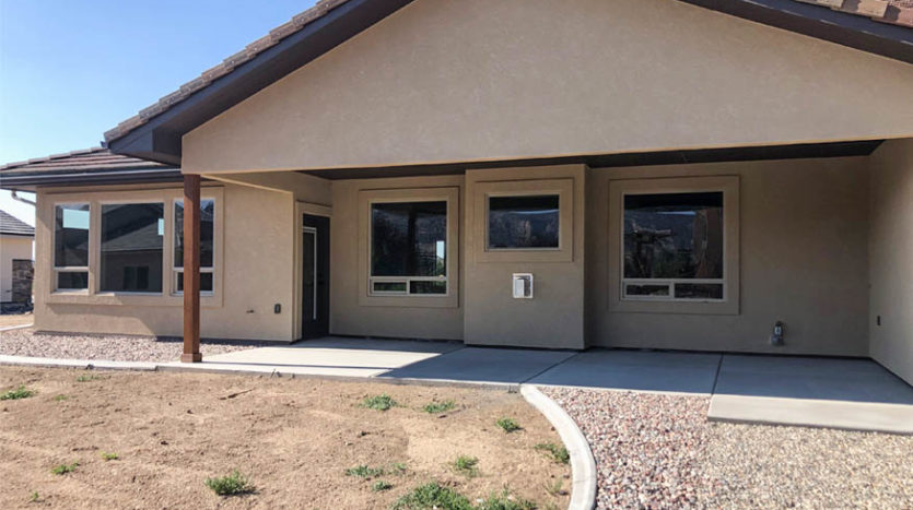 The back patio of 1484 Shoreline is covered, and backs up to the living room.