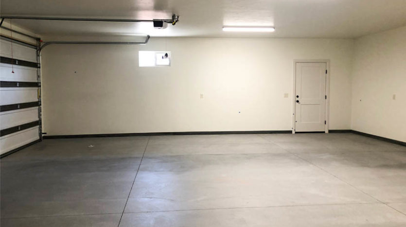 The 3 car garage in 1484 Shoreline Drive has an operable window, faces east, and has access on the north wall to the RV area.