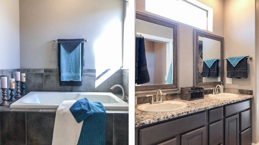 The soaking tub and vanity in the master bath of 1446 Shoreline Dr.