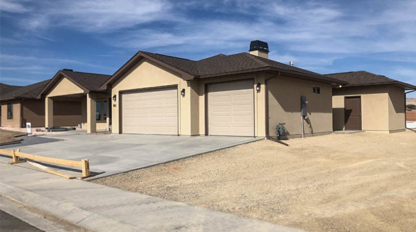 852 Fire Agate has a 3-car garage + RV parking area along the south end of the lot.