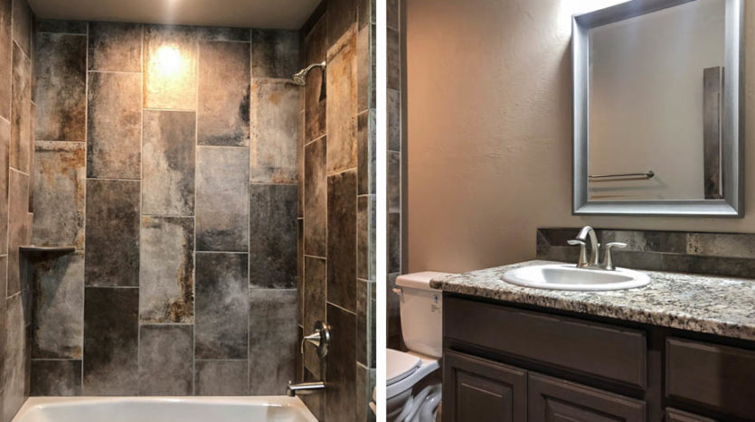 The hall bath of 852 Fire Agate has custom tile work in the shower, and a granite countertop on the vanity.