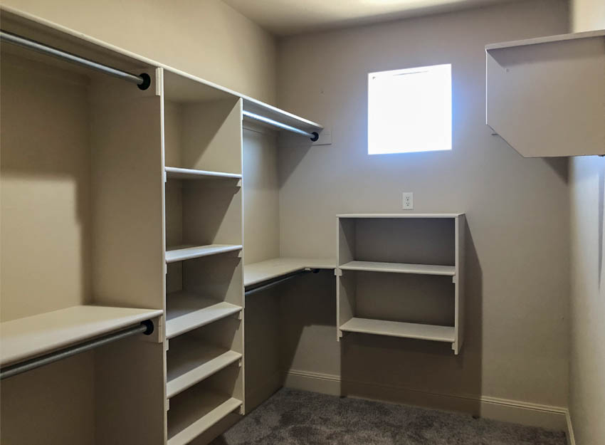 The master closet of the Amethyst model has shelving and hanging space.