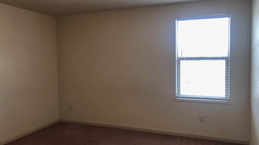 The bedroom in the south west corner of the upstairs overlooks the back yard, and includes a walk-in closet.