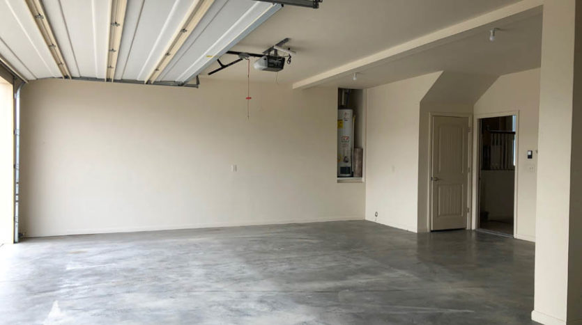 The 3 car garage of 165 Winter Hawk offers space for parking and storage.