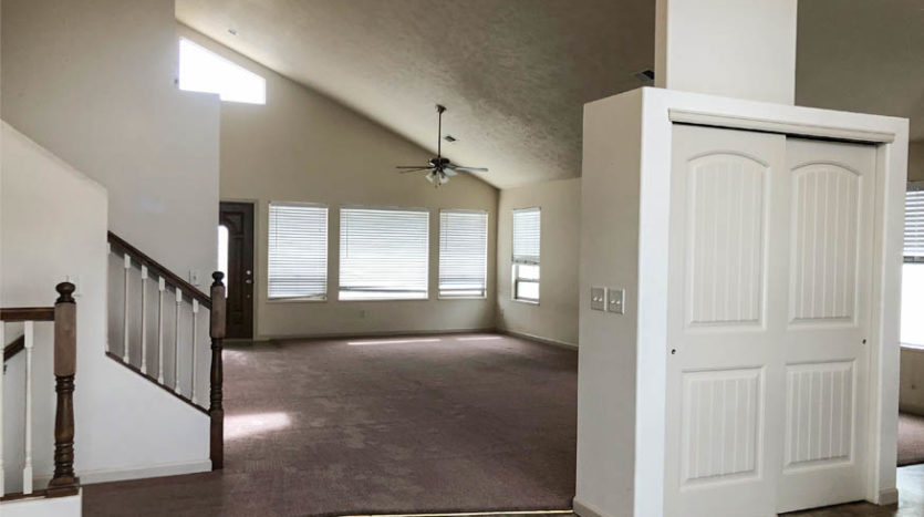 The living and dining rooms of 165 Winter Hawk have vaulted ceilings and ceiling fans.