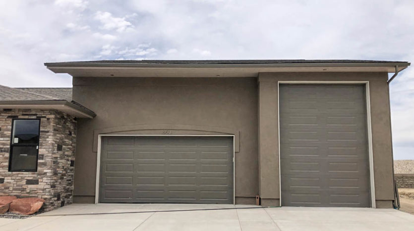 the garage of 853 Fire Agate Lane includes a 2-car bay and a RV bay with a 10-x14' door.