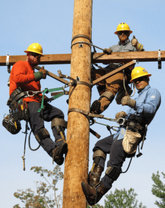 lineworkers on top of poll