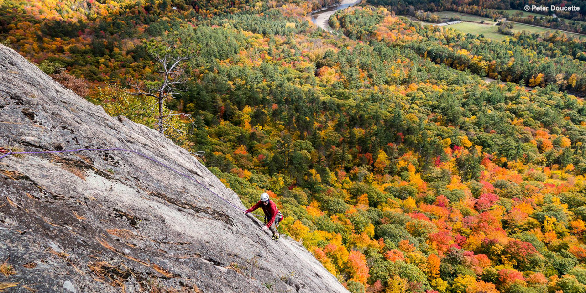 Climbing in White's Ledge in Bartlett, NH. Photo by Peter Doucette.