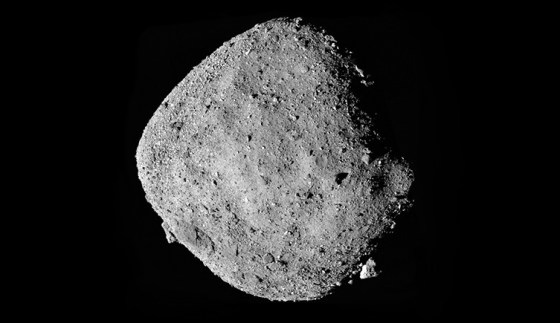 A composite picture showing the asteroid Bennu, with a grey rocky surface on a black background of space.