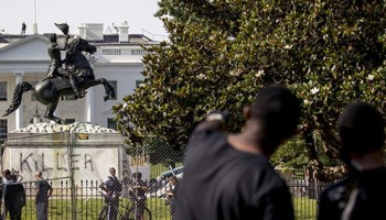 Officers clear protesters from outside White House, as 'Defund the Police' graffiti removed