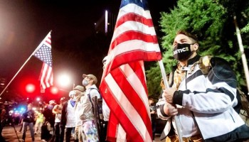 Portland sees 150-round shooting at apartment building, as crowds continue violent clashes with police