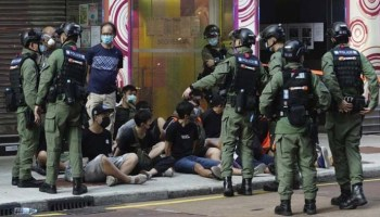 Hong Kong police arrest dozens of protesters as government delays elections
