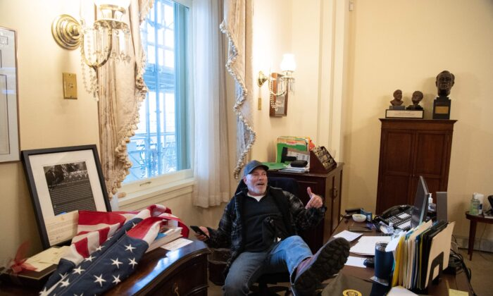 Man Who Posed for Photos at Desk in Pelosi's Office Arrested