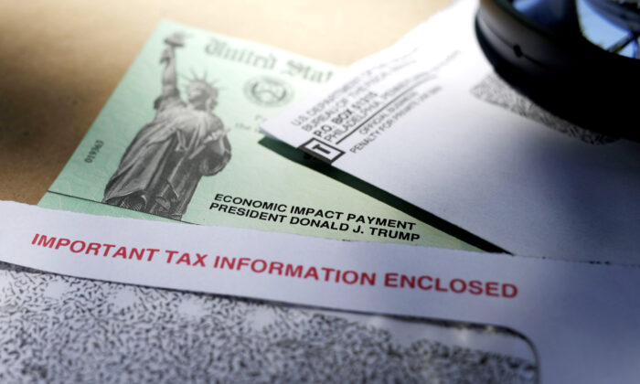 IRS Starts Processing $1,400 Stimulus Checks, Payments to Start Showing up This Weekend