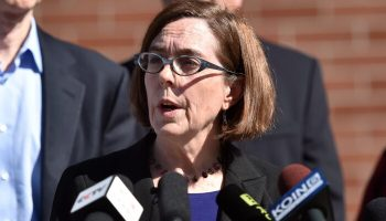 Oregon Police and Firefighters Sue Governor Over COVID-19 Vaccine Mandate