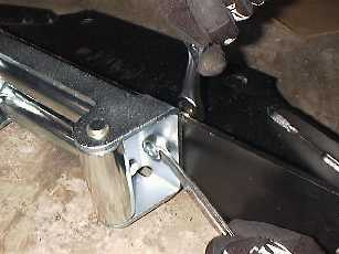 Mount the roller fairlead to the winch plate.