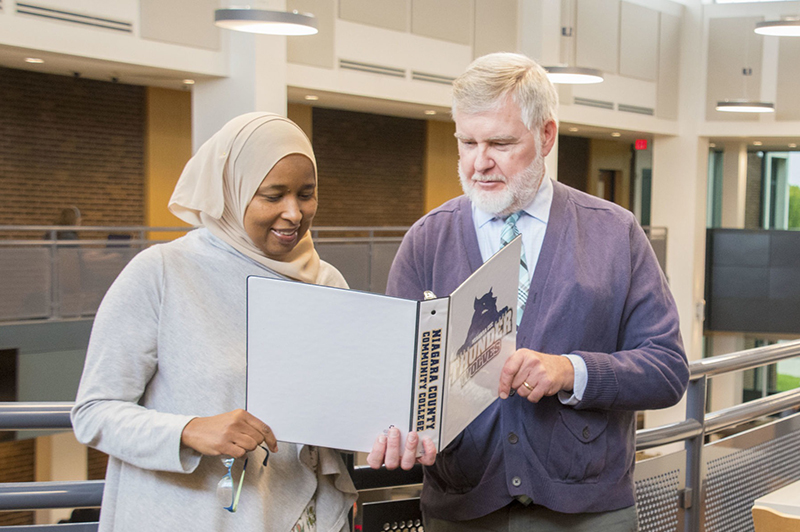 Diverse student and NCCC Faculty member