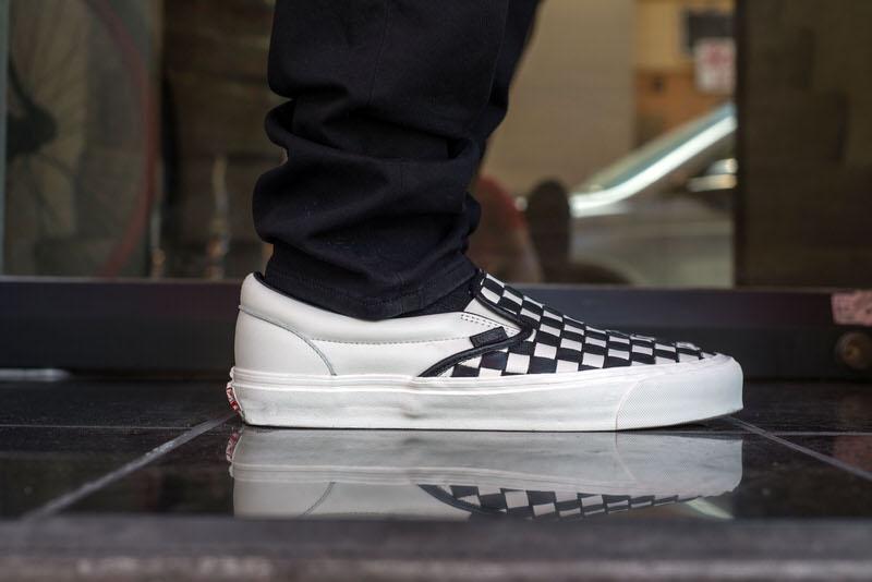vans slip on all black on feet 772b5eb9d