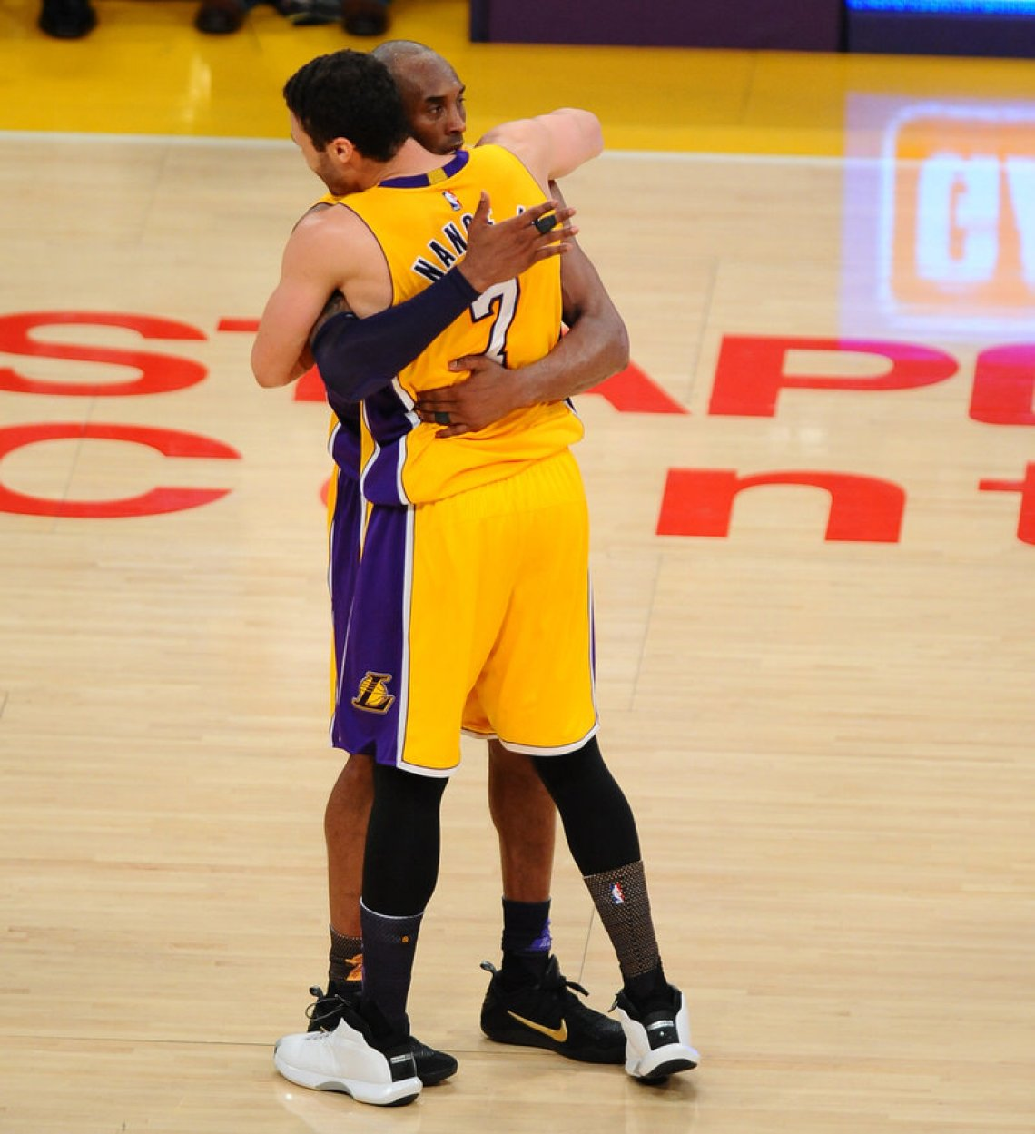 LOS ANGELES, CA - APRIL 13:  Kobe Bryant #24 and Larry Nance Jr. #7 of the Los Angeles Lakers hug after the game against the Utah Jazz on April 13, 2016 at Staples Center in Los Angeles, California. NOTE TO USER: User expressly acknowledges and agrees that, by downloading and/or using this Photograph, user is consenting to the terms and conditions of the Getty Images License Agreement. Mandatory Copyright Notice: Copyright 2016 NBAE (Photo by Juan Ocampo/NBAE via Getty Images)