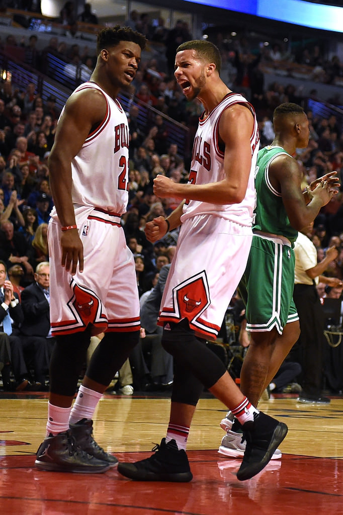 a35a6970932 ... Jimmy Butler and Michael Kidd-Gilchrist celebrate in the Air Jordan  XXX1