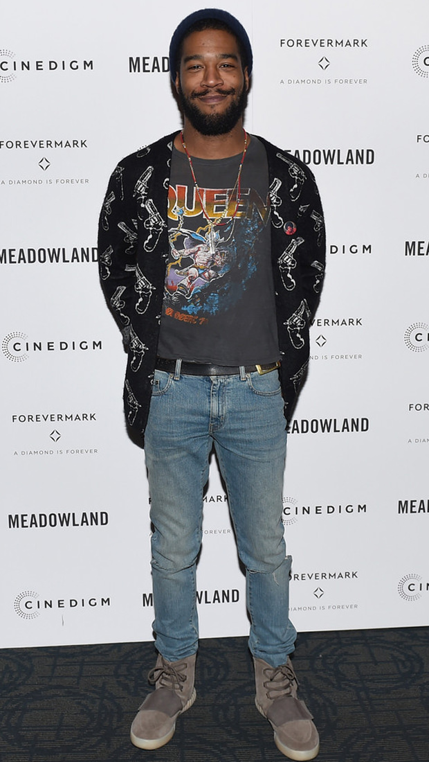 Kid Cudi is officially the man on the moon. His style is futuristic (Yeezy 750s) and timeless (Vintage Queen tee) all at the same time.